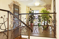 Classical stairs with ornamental handrail in hallway with doors Royalty Free Stock Photos