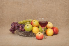Classical still-life with fruit and a glass Stock Photos