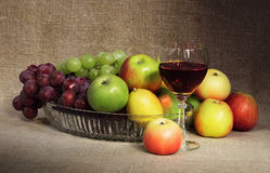 Classical still-life with fruit and glass of wine Royalty Free Stock Images