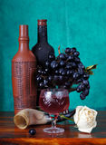 Classical still life with grapes and wine. Classical still life with grapes and a wine bottles Stock Photo