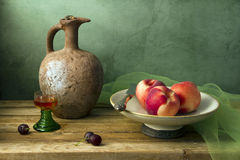 Classical still life with vintage pitcher and frui Stock Image