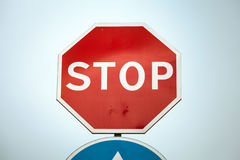 Classical Stop road sign over blue sky Royalty Free Stock Images