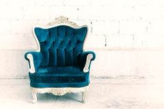 Classical style armchair sofa. Couch in vintage room Royalty Free Stock Photo