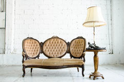 Classical style Armchair sofa couch in vintage room with desk la Stock Photos