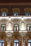 Classical style building. Evening lighting. Windows with stucco and tile. Moscow Stock Images