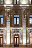 Classical style building. Evening lighting. Windows with stucco and tile. Moscow Royalty Free Stock Photo