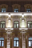 Classical style building. Evening lighting. Windows with stucco and tile. Moscow Royalty Free Stock Image