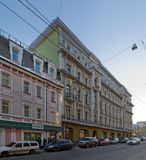 Classical style building. Evening lighting. Windows with stucco and tile. Moscow Stock Photography
