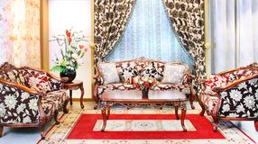 Classical stylish armchairs sitting room. Classical stylish armchairs furniture with coffee-table displayed in a sitting room Royalty Free Stock Photos