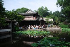 Classical suzhou garden. Liu Garden with pond in summer, Suzhou, Jiangsu, China. Designated as a world heritage site by UNESCO. Water and trees surround the Royalty Free Stock Photography