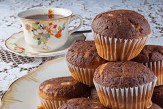 Classical tea time with muffins. Classical tea time with tasty muffins over retro ambient with porcelain dishes Stock Image