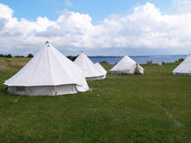 Classical tents by the beach ocean Royalty Free Stock Images
