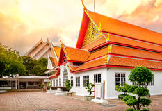Classical Thai  architecture in National Museum of Bangkok, Thailand. Classical Thai  architecture of National Museum at dramatic orange sunset sky, Bangkok Stock Photography