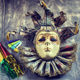 Classical venetian carnival mask and blowers Royalty Free Stock Photo