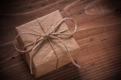 Classical vintage gift box with string bow on wooden board Royalty Free Stock Image
