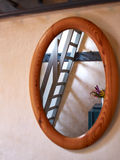 Classical vintage oval wooden mirror Stock Photos