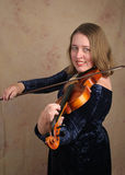 Classical Violinist 1. A vertical portrait of a classical violinist playing her instrument Royalty Free Stock Images
