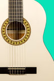 Classical white acoustic guitar fragment with strings and soundb. Detail of classic white acoustic wooden guitar with strings and soundboard socket isolated on Stock Photos