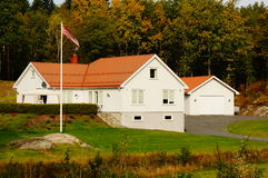 Classical white farm house, Norway. Norwegian classical white wood house farm. Kragero city Telemark, Norway.  Autumn in Norway Stock Photography