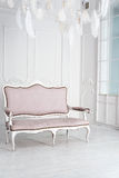 Classical white interior with pink sofa. Stock Photos