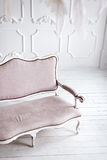 Classical white interior with pink sofa. Royalty Free Stock Photo