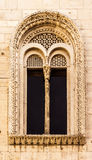 Classical window. An antique window with a lot of complex carvings and friezes Stock Images
