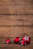 Classical wooden background for christmas with red and white bal Royalty Free Stock Image