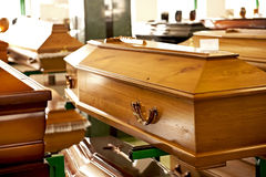 Classical wooden casket. The classical wooden casket displayed in a casket store Royalty Free Stock Photos