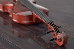 Classical Wooden Violin with Bow. 3d Rendering. Classical Wooden Violin with Bow on a wooden table. 3d Rendering Royalty Free Stock Image