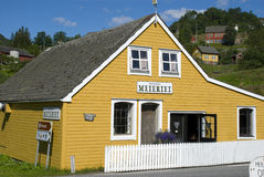 Classical yellow scandinavian wooden house in norway Royalty Free Stock Photography