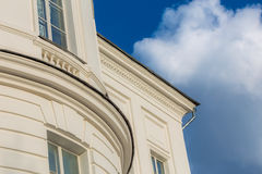 Classicism style white house fragment. Classicism style white house architecture fragment with blue sky and white cloud Royalty Free Stock Photography