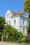 Classicism villa. Elegant classicism villa mit two floor und bushes in front Stock Photo