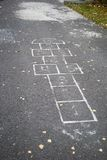 Classics. The Figure for children's play hopscotch on the pavement stock photography