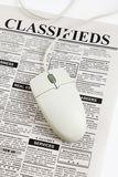 Classified Ad and computer mouse. Fake Classified Ad, newspaper, business concept Stock Photo