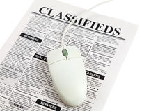 Classified Ad and computer mouse. Fake Classified Ad, newspaper,  concept Stock Photo
