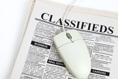 Classified Ad and computer mouse. Fake Classified Ad, newspaper,  concept Royalty Free Stock Photography