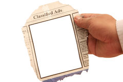 Classified Ads. Hand holding a classified ads- many uses in the employment and resources stock photo