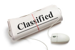 Classified. Computer mouse and Newspaper Roll with white background Stock Image