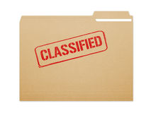 Classified Folder. Classified brown folder file with paper showing with a lot of copy space. Isolated on a white background with clipping path Royalty Free Stock Photo