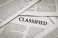 Classified headline. On newspaper background Royalty Free Stock Photo
