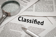 Classified headline. On newspaper background Royalty Free Stock Photos
