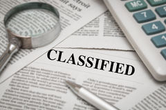 Classified headline. On newspaper background Stock Photography