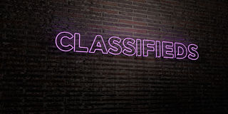 CLASSIFIEDS -Realistic Neon Sign on Brick Wall background - 3D rendered royalty free stock image. Can be used for online banner ads and direct mailers Stock Photo