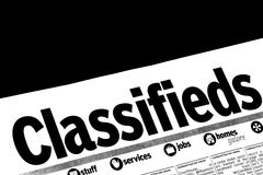 CLASSIFIEDS section of the newspaper Royalty Free Stock Photo