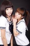 Classmate girls. Two beautiful schoolgirls in uniform on Royalty Free Stock Images