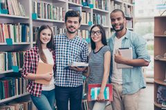 Classmate, international friendship, communication, education an. D teenage concept. Group of cheerful students in casual outfits with note books, devices are stock photo