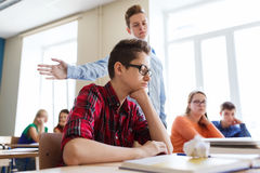 Classmate offending student boy at school Royalty Free Stock Image