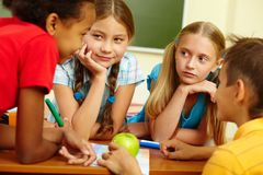 Classmates chatting stock photo