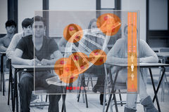 Classmates concentrated on futuristic interface with DNA. On it stock photography