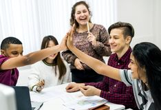 Classmates giving a high five teamwork and success concept royalty free stock images